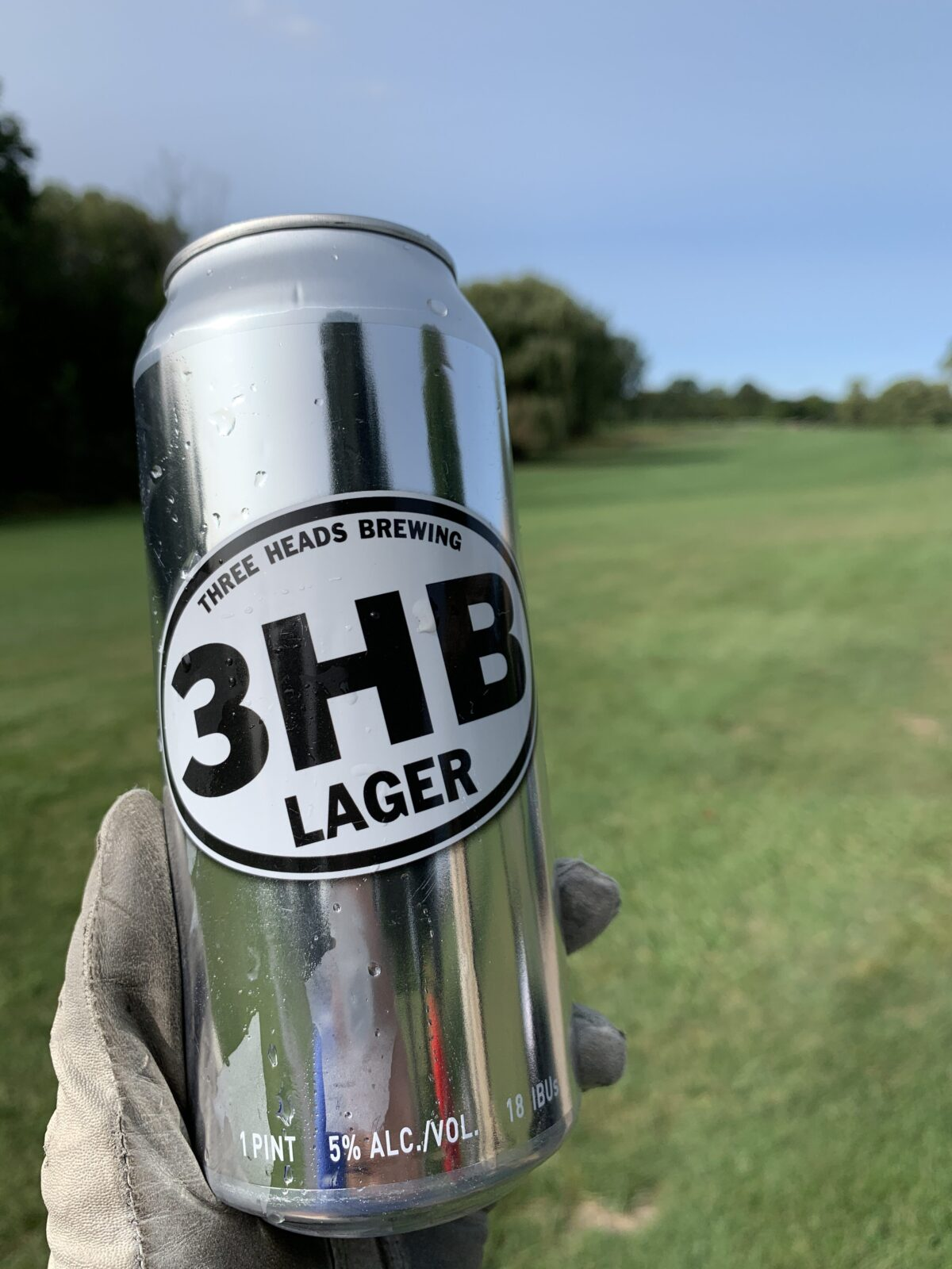 three heads beer on golf course